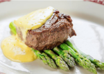Filet bearnaise, a 4-ounce filet mignon with steamed asparagus and bearnaise sauce, is now available on Gene & Georgetti's new prime time menu in its lounge area.