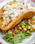 Gene & Georgetti's new prime time menu includes the chicken salad pita -- chilled diced poached chicken combined with vegetables and served in a pita pocket.