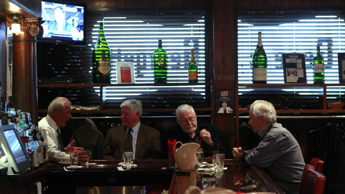 Regular customers hold down the bar at Gene & Georgetti in 2012. This weekend, the steakhouse celebrates its 75th anniversary with a special menu. (Chris Walker / Chicago Tribune)