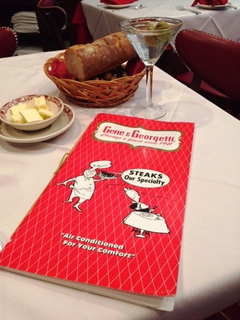 Menu, bread basket, and a martini at the legendary Gene and Georgetti's in Chicago. //Tinker Parker
